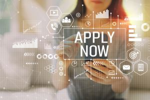 Apply now with woman using a smartphone