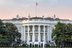 The White House in Washington DC with american flag on sunset sky at sunset
