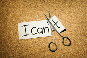 """paper that says """"I can't"""" with scissors cutting off the """"t"""""""
