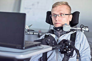 student in wheelchair with speaking assistive tech