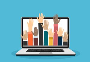 hands raised through laptop